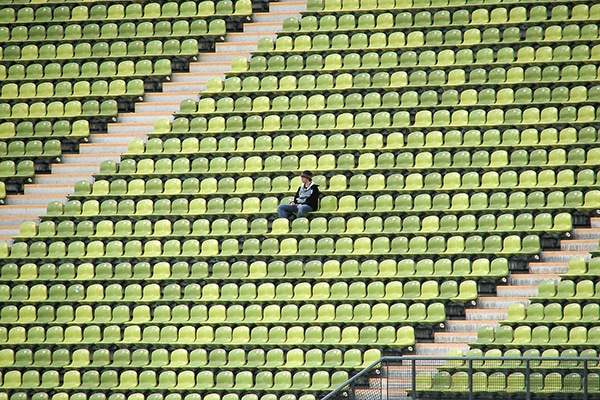 Man sitting alone in stadium